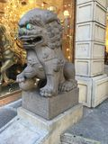 Chinatown`s Dragon Gate, guardian male lion, 4. Often miscalled `Foo Dogs`, the guardian lion originated with the Chinese Buddhist. By Chinese tradition, there royalty free stock images