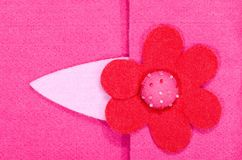 Close up on pink felt flower on fabric. o royalty free stock image