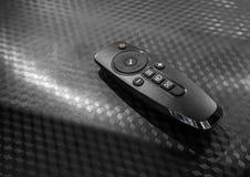 Ogólnoludzki pilot do tv odizolowywający na czarnym tekstury tle Obrazy Stock