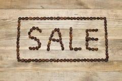 Ogłoszenie sprzedaż robić kawowe fasole fotografia stock