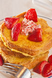 Oganic cornmeal crusted french toast with strawberries Royalty Free Stock Photo