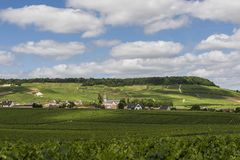 Oger in Champagne District. Avize, France - June 12, 2017: The small Champagne village Avize/Oger near Epernay with vineyards and hills on a summers day in Stock Image