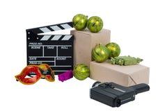 Oggetti di film sparsi su un fondo bianco Immagine Stock