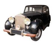 Oggetto d'antiquariato, automobile nera, isolata contro un fondo bianco Immagini Stock