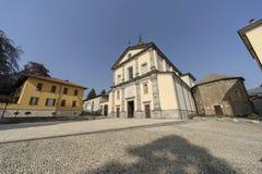 Oggiono, Italy: historic monuments. Oggiono, Lecco, Lombardy, Italy: the Sant`Eufemia church, in baroque style, and the baptistery of San Giovanni Battista, in royalty free stock photos
