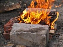 Ogień, rozogniający na grabie Zdjęcie Royalty Free