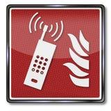 Ogień, telefon w sprawie nagłego wypadku i telefon komórkowy, Fotografia Royalty Free