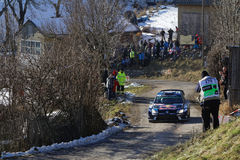 Sebastien Ogier drives his Polo in the mountains Royalty Free Stock Photography