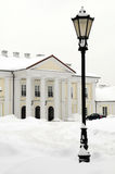 Oginski Palace in Siedlce, Poland in winter. Oginski Palace in Siedlce, Poland covered with snow in winter with street light in the foreground Stock Photography