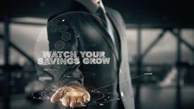 Ogląda Twój Savings Rosnąć z holograma biznesmena pojęciem obraz stock