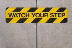 Ogląda twój krok budowy znaka ostrzegawczego Obraz Royalty Free