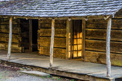 Ogle Place, Roaring Fork Motor Trail, Great Smoky Mountains. Warm evening light through the front door of the old Noah Bud Ogle cabin Along the Roaring Fork Royalty Free Stock Images