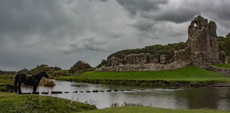 Ogmore castle. A view of Ogmore Castle and the Stepping stones across the Ewenny river. Ogmore, Bridgend, Wales Royalty Free Stock Photography