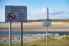 Danger sign, Ogmore estuary. Ogmore by sea, the estuary near low tide including the public information signs Stock Images
