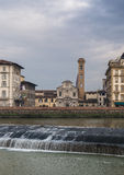 Ognissanti church in Florence and Arno river kiddle Royalty Free Stock Images