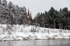 Ogre river in winter. Banks of Ogre river in winter and lutheranic church city of Ogre, Latvija Royalty Free Stock Images
