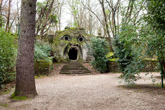 The Ogre Statue Bomarzo, Italy. BOMARZO, LAZIO, ITALY - JANUARY 10, 2015: The Ogre or Orcus Mouth is the most famous statue in The Park of the Monsters (Sacred Stock Images