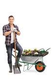 Ogrodniczka pozuje z ogrodnictwa wyposażeniem Obraz Royalty Free