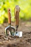 Ogrodowi narzędzia wtykający w ziemi Zdjęcia Royalty Free