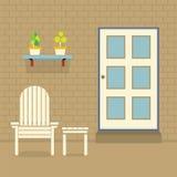 Ogrodowy krzesło I stół Z garnek roślinami Na ściana z cegieł Obrazy Stock