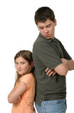 Oh Brother!. Siblings. Big brother scowls down at little sister who has a smirk on her face. Getting along? Favortism? What could it be stock image