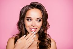 Oh! Close up of girlish gorgeous charming lady with arm gently t. Ouching ideal face, amazing wavy nice modern trendy hairstyle, full pink lips. Pampering, lips Royalty Free Stock Photos