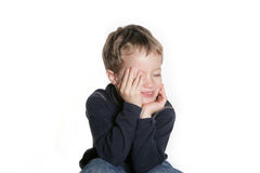 Oh so cute. Four year old boy giggling and covering part of his face Stock Photos