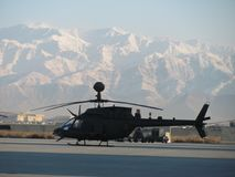OH-58D at snowy Bagram Airbase. An OH-58D helicopter on the flight line at Bagram Airbase Afghanistan Royalty Free Stock Image