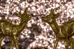 Oh Dear. Golden dear used as home decoration on a silvery bokeh background Royalty Free Stock Photo