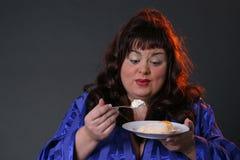 OH - I like it!. Big girl eating cake royalty free stock photography