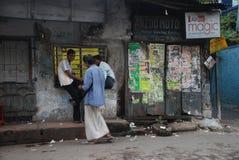 Oh Kolkata !. A lazy afternoon collage of street mood that makes up of Kolkata (Calcutta) e.g. cinema posters, local folks chatting lazily (\\\'Adda\\\'), a Stock Photos