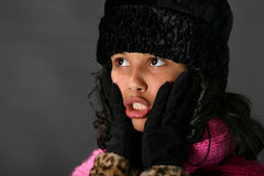 Oh my. Young woman dressed for cold weather looking shocked stock photo