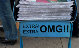 Oh my god. Newspaper stack - take one of these newspaper in the subway entrance Royalty Free Stock Images