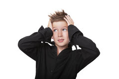 Oh my god. Charming expressive boy touching his head with both hands isolated on white background Royalty Free Stock Images