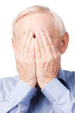 Oh my God!. Frustrated senior man covering his face by hands while standing against white Stock Photos