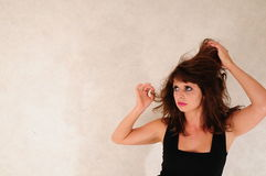 Oh! my hair. Model in the right bottem corner looking to top left holding her hair up Stock Images