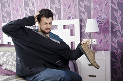 Oh my head!. Hangover morning and confused man, inverted dressing Royalty Free Stock Image