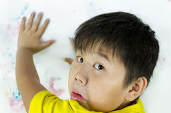 Oh no. A child being caught while painting on the wall Stock Photography