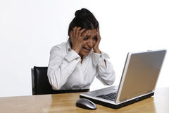 Oh No. Indian woman at her laptop holding her head in anguish stock photos