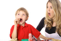 Oh NO child tasting cookie batter Stock Images