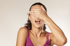 Oh no. Desperate young brunette covering her face with her hand Royalty Free Stock Images