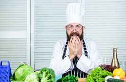 Oh no. Healthy food cooking. Mature hipster with beard. Vegetarian salad with fresh vegetables. Dieting organic food. Cuisine culinary. Vitamin. scared bearded stock image