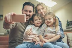 Oh no, self portrait again. Family at home royalty free stock images