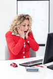 Oh no - shocked business woman. In front of computer in the office royalty free stock photo