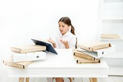 Oh no, the text is too long. Schoolgirl reading school book at desk. Little girl reading lesson book in school. Small stock images