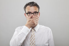 Oh Sh*t. Man holds his hand to his mouth due to sickness or wrong decision royalty free stock photography