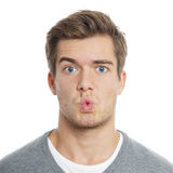 Oh!. Surpised young man with funny facial expression Stock Images