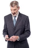 Oh ! There is a new message!. Business man using his android device Royalty Free Stock Photography