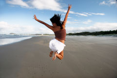 Oh what a feelin. Girl jumping Stock Photo