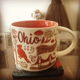Ohio coffee mug on desk. Orange and white, state bird stock image